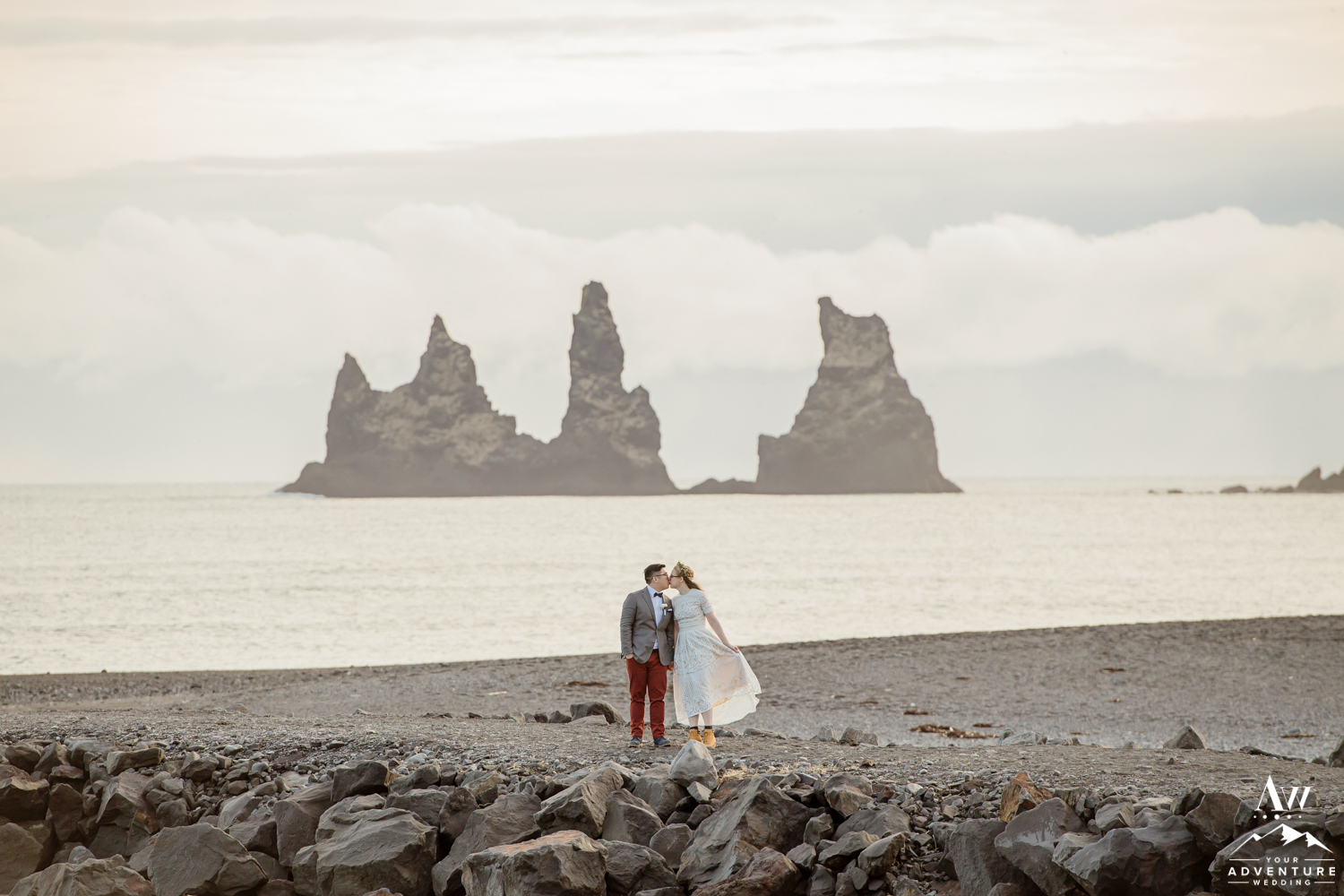 Couple kissing on Iceland wedding day in front of Reynisdrangar