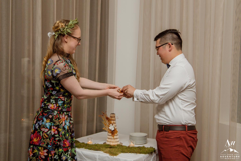 Couple breaking their Iceland Wedding Cake
