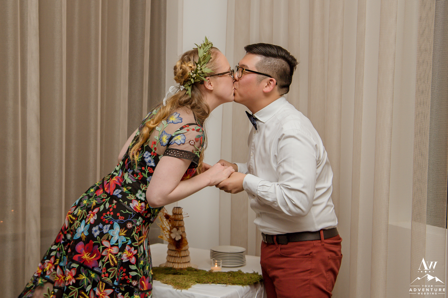 Couple Kissing in front of their Iceland Wedding Cake