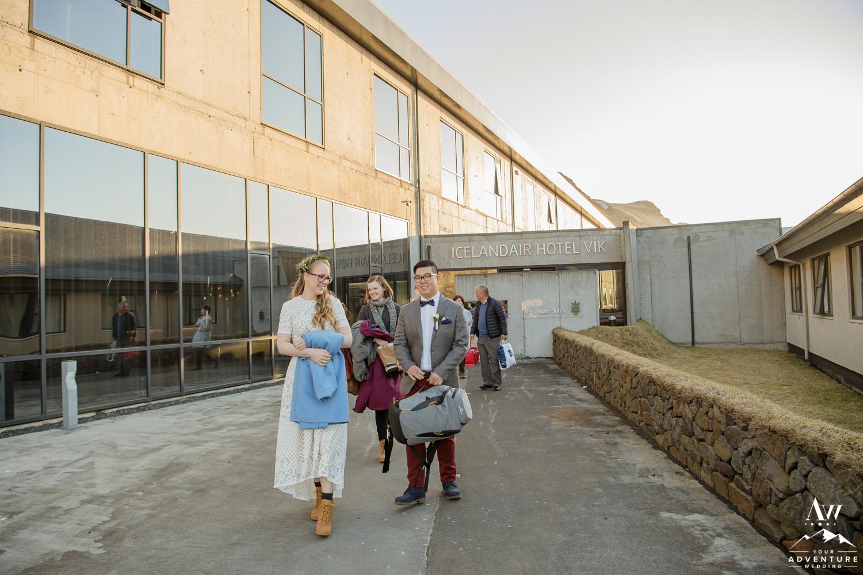 Bride and Groom Walking out of Icleandair Vik