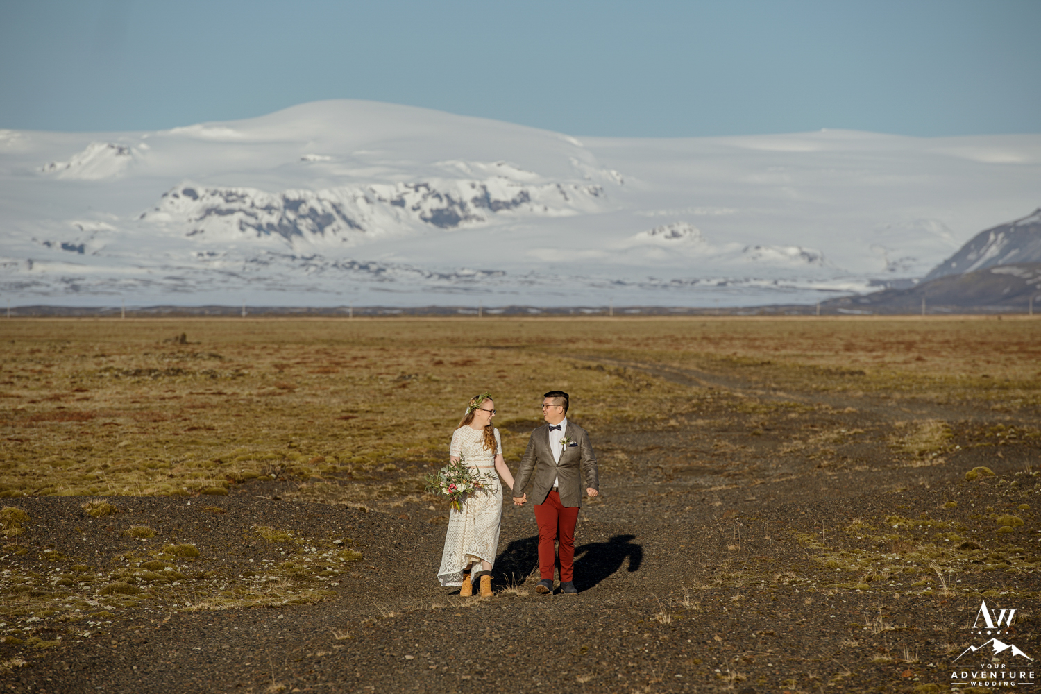 Bride and Groom standing in front of a glacier
