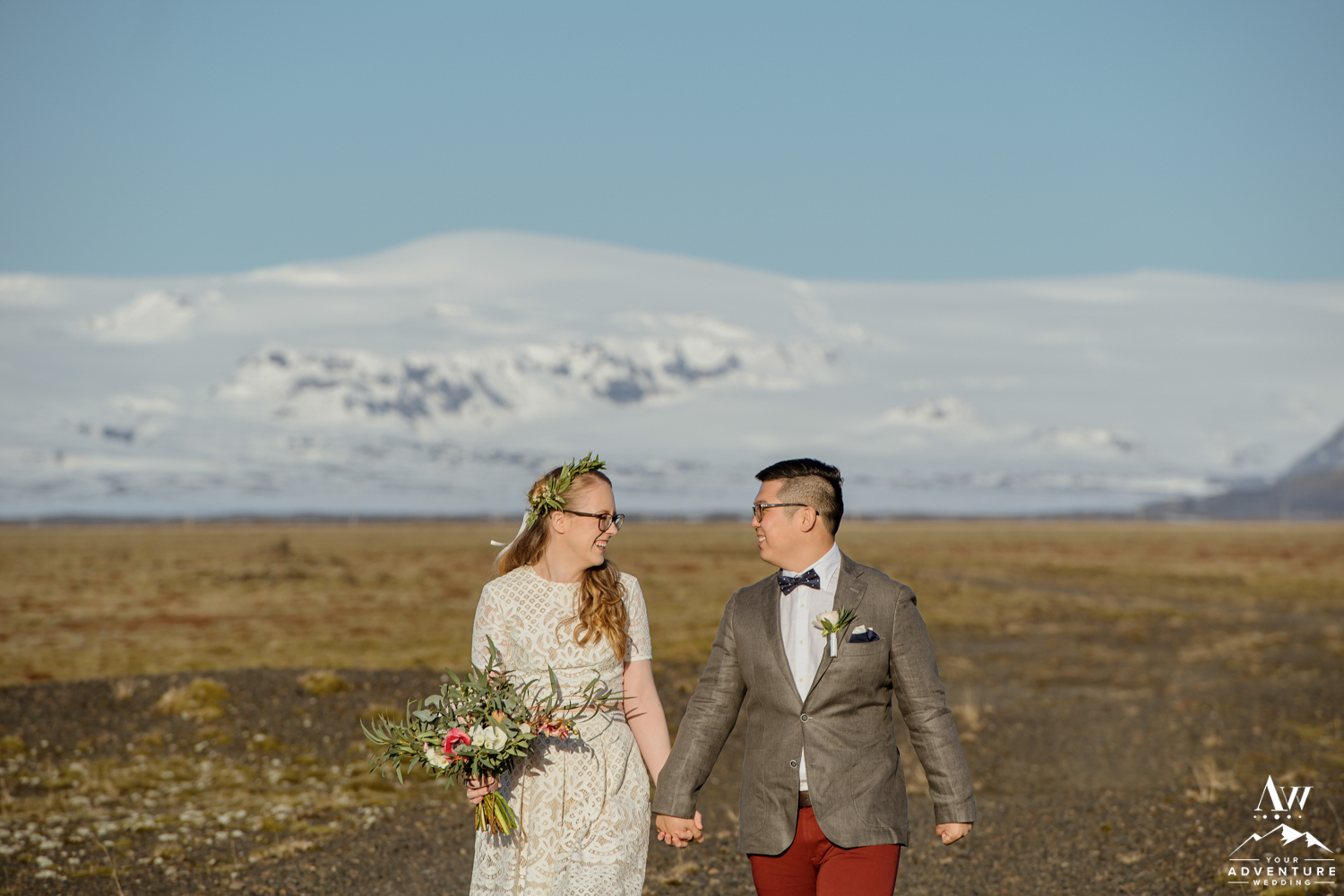 Iceland Wedding Couple laughing in front of a snow covered mountain