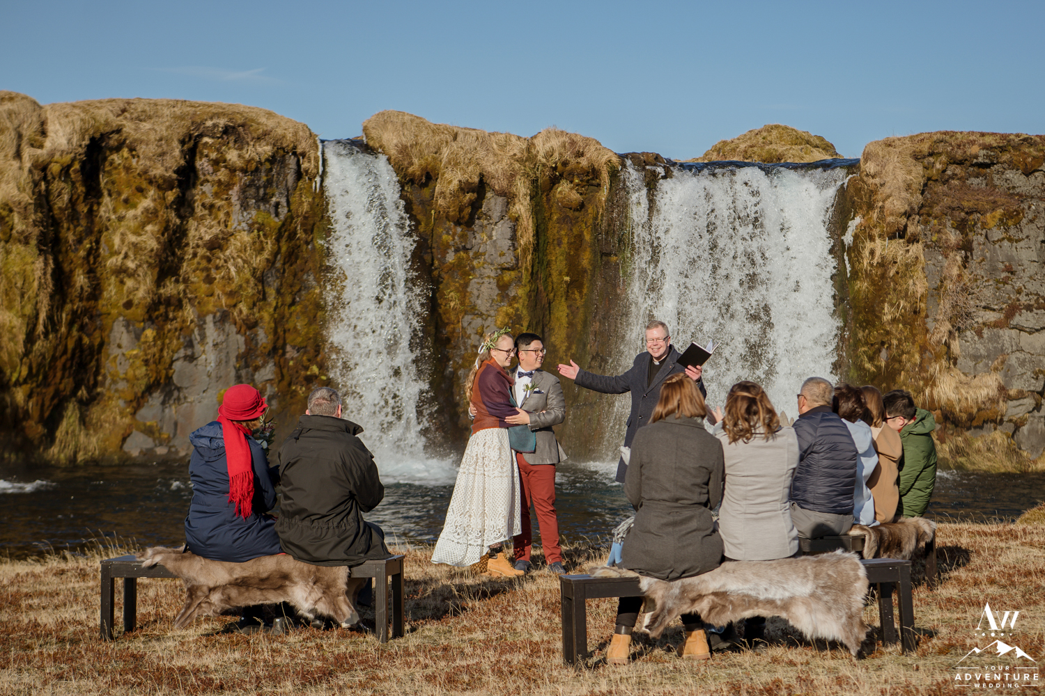Couple Kissing at Iceland Waterfall Wedding
