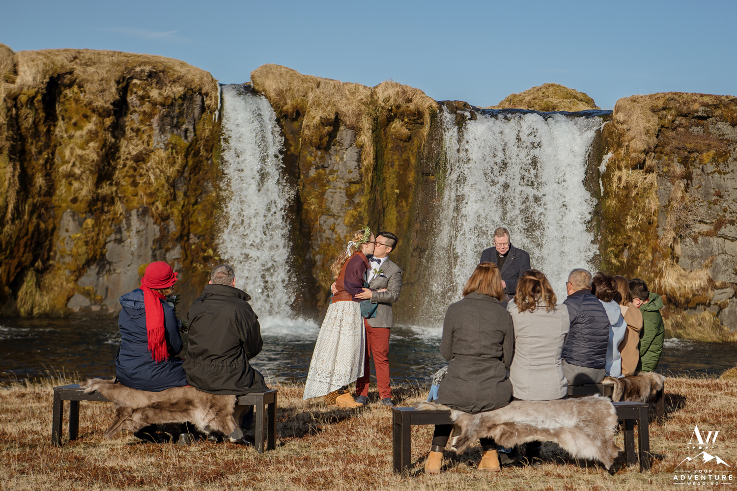 Bride and Groom Kissing at Iceland Waterfall Wedding Ceremony