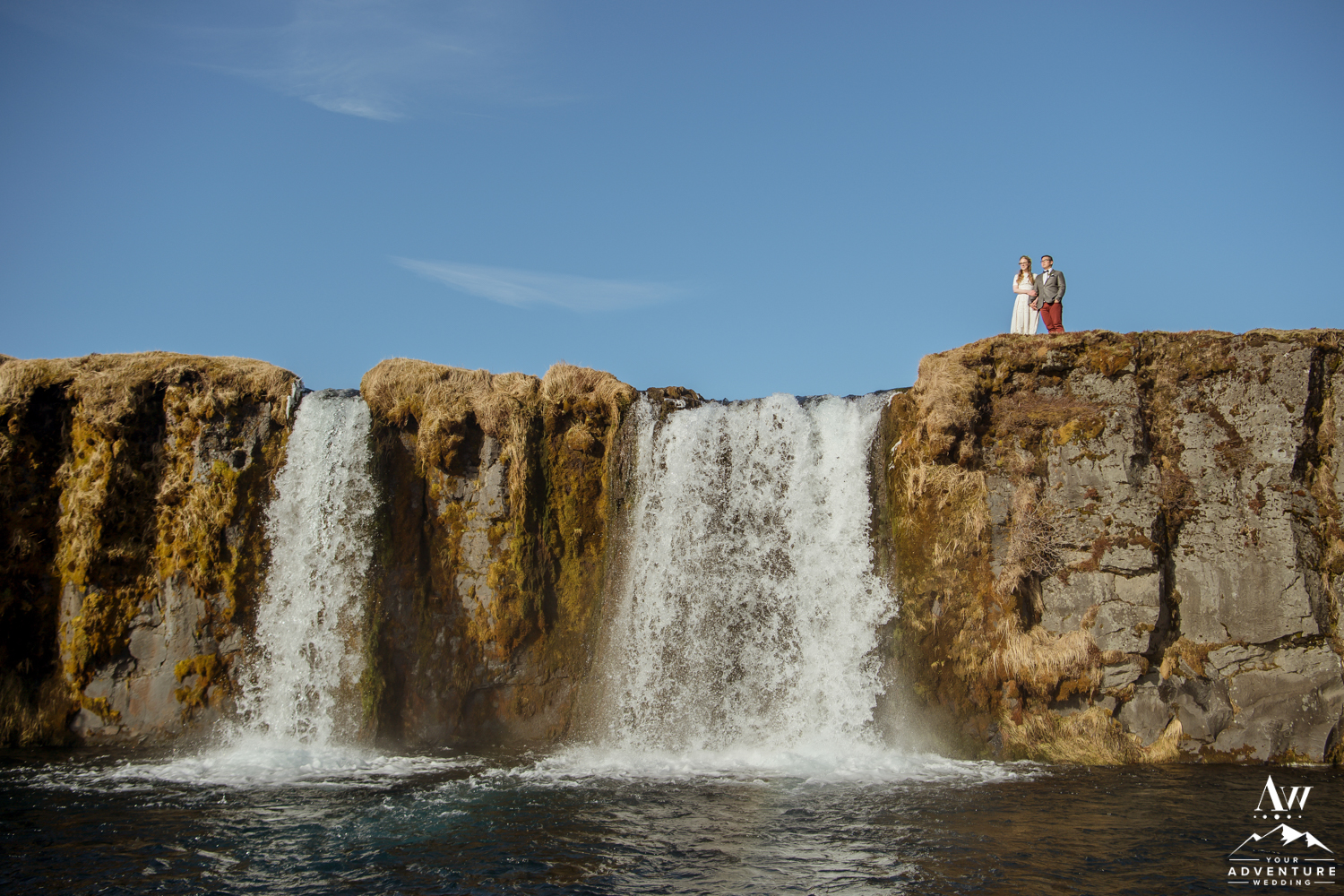 Couple on top of a Waterfall in Iceland