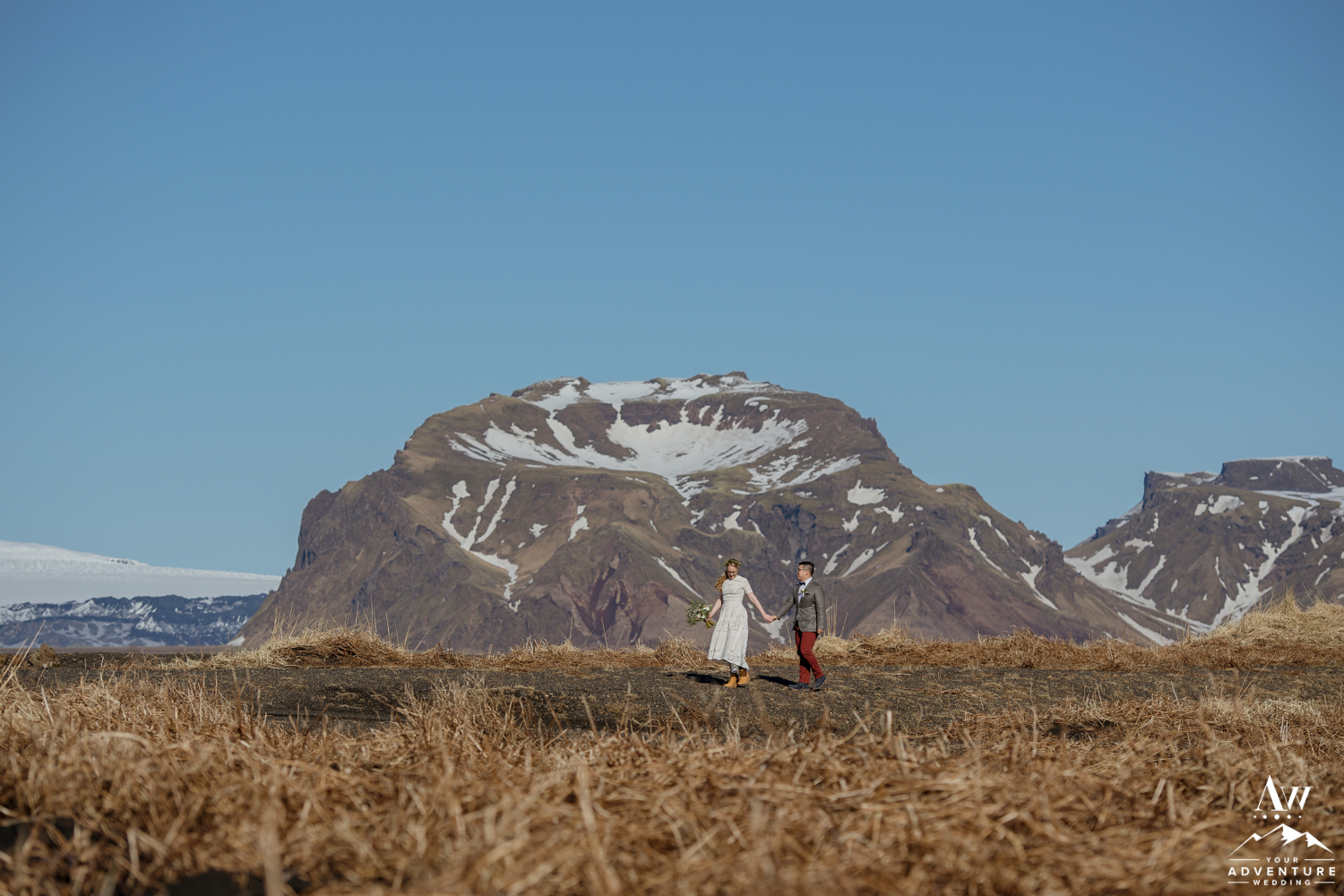 Couple Standing in Front of a Mountain