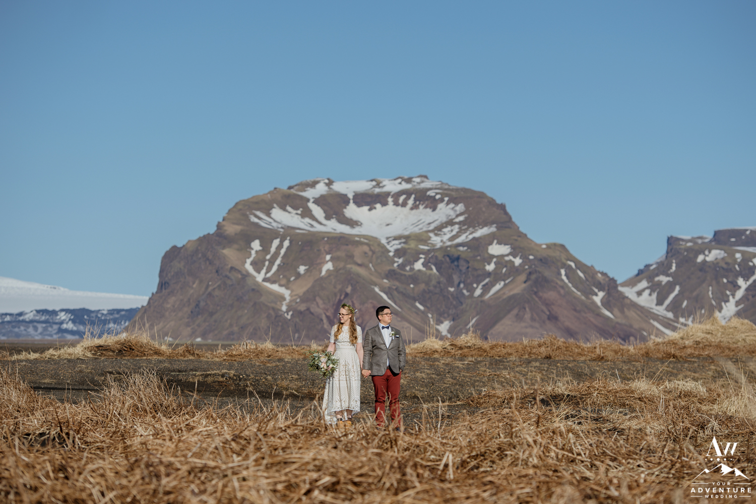 March wedding in Iceland Couple with Mountain Behind