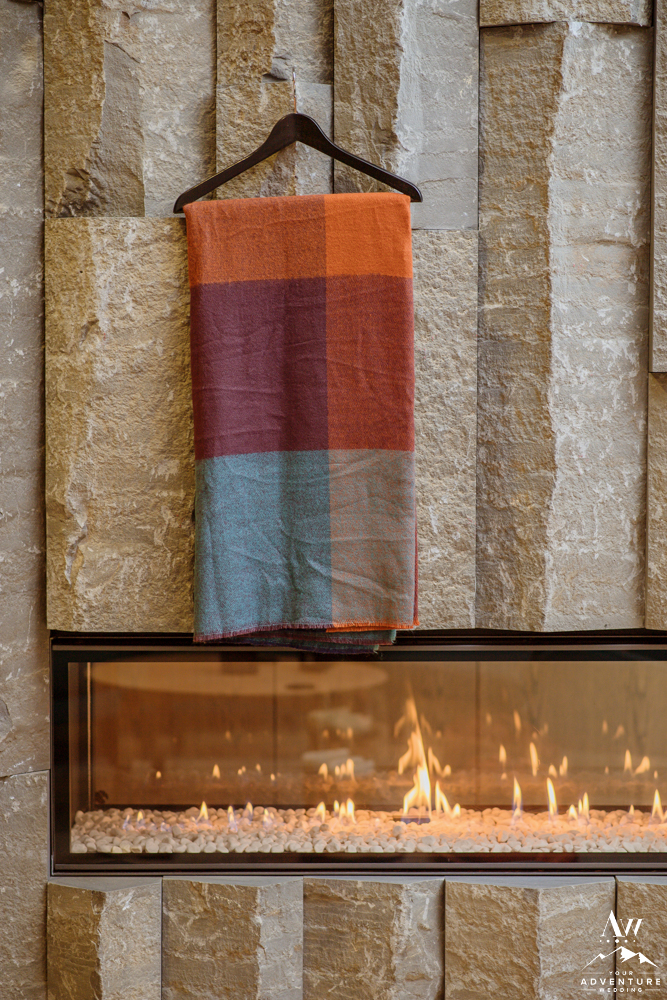 Iceland Wedding Shawl Hanging over a Fireplace