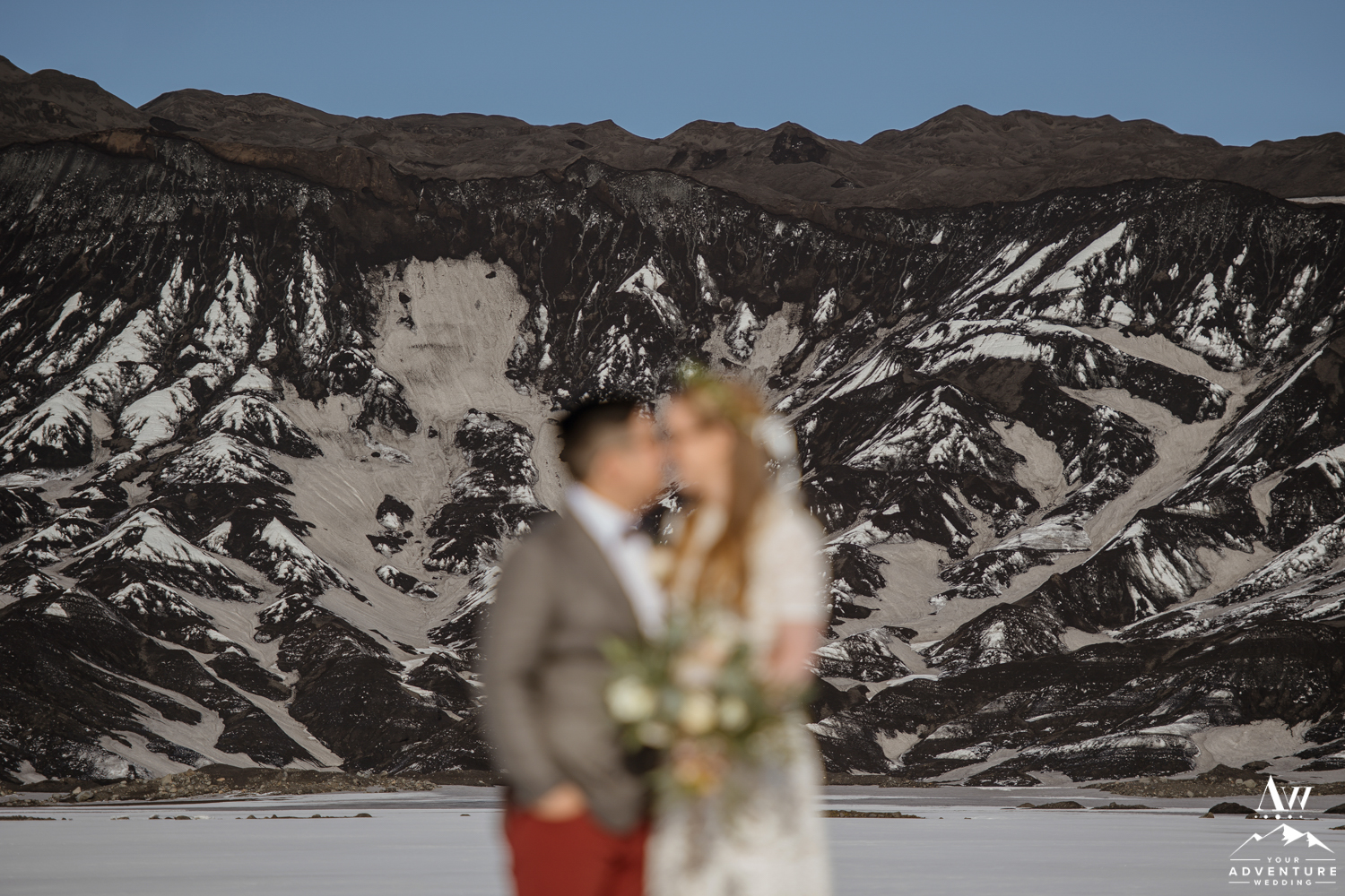 Wedding Couple in Front of a Black Glacier in Iceland