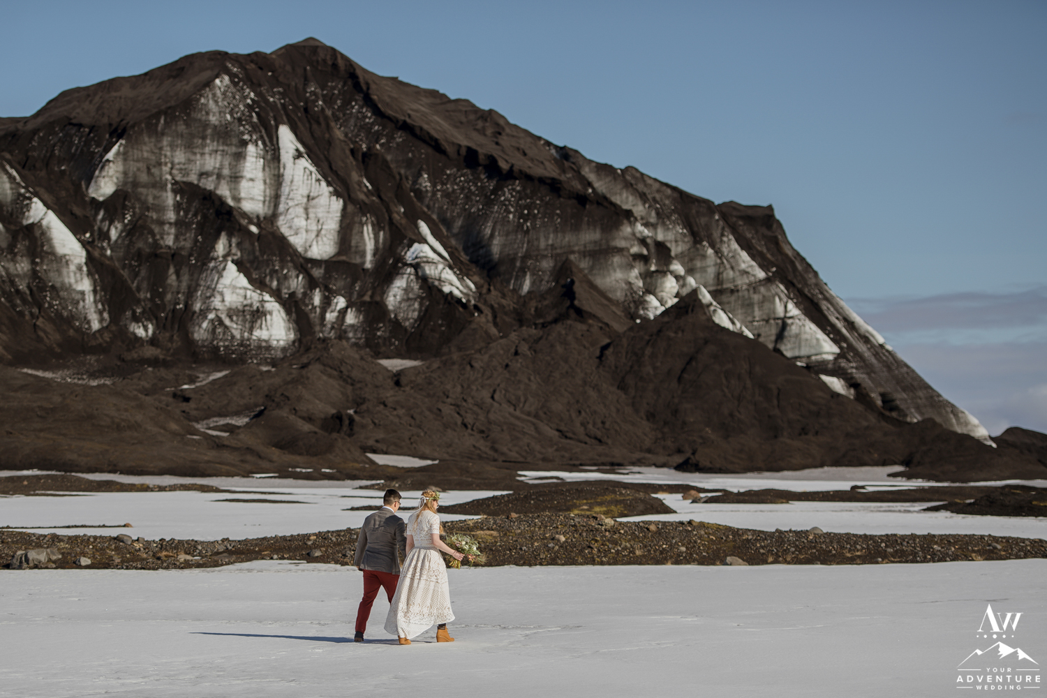 Iceland Wedding couple walking to a glacier