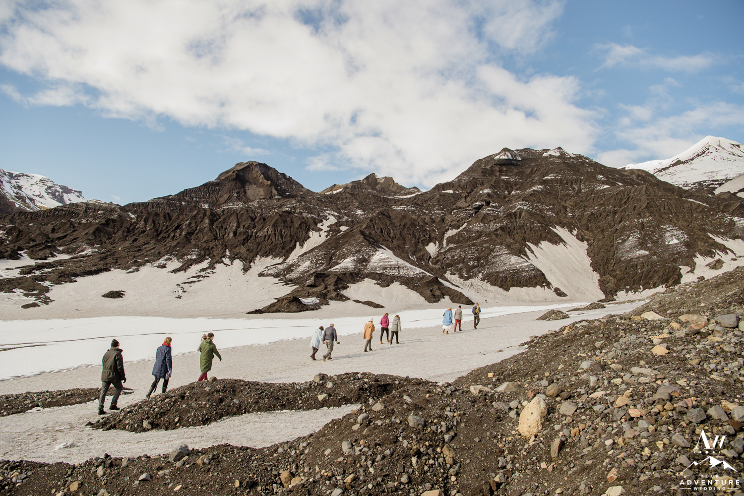 Group Hiking to an ice cave during Iceland Wedding Adventure
