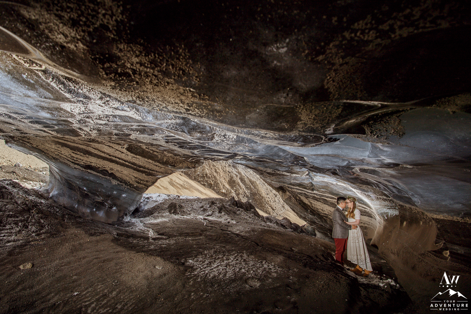 Wedding couple inside of a natural Ice Cave in Iceland