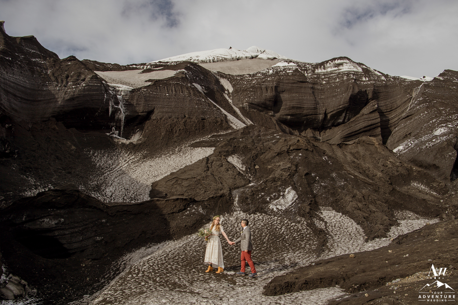Couple Exploring a glacier ice cave area in Iceland