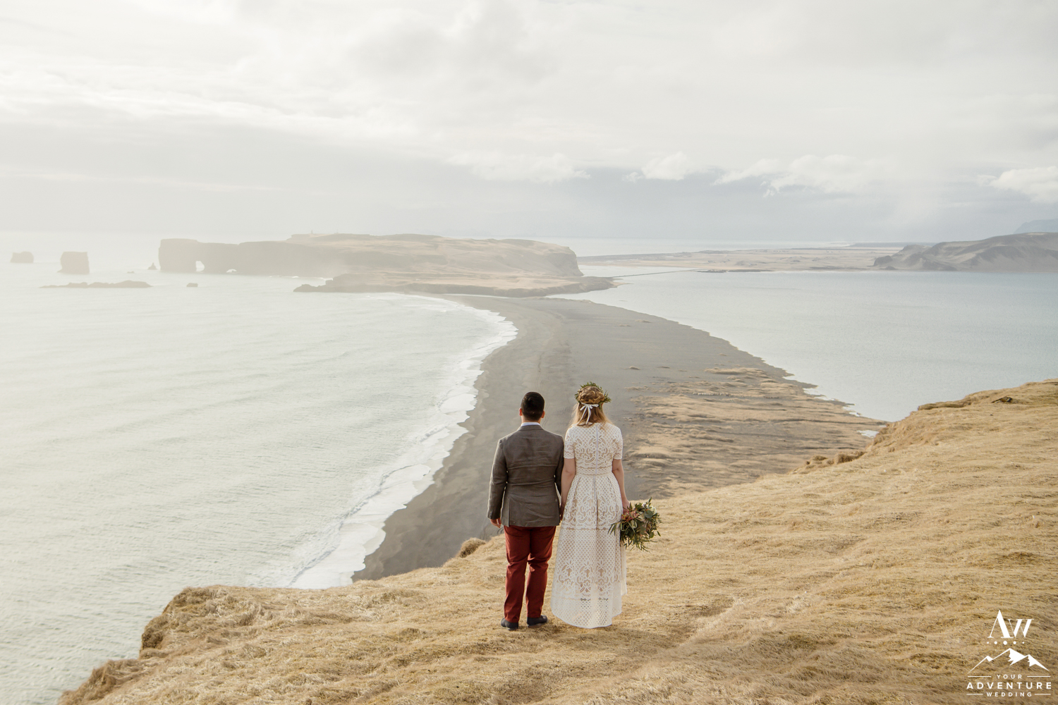 Wedding Couple looking out towards Dyrholaey Sea Arch