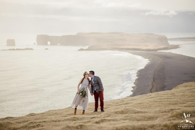 Iceland wedding couple kissing on Reynisfjarall Mountain