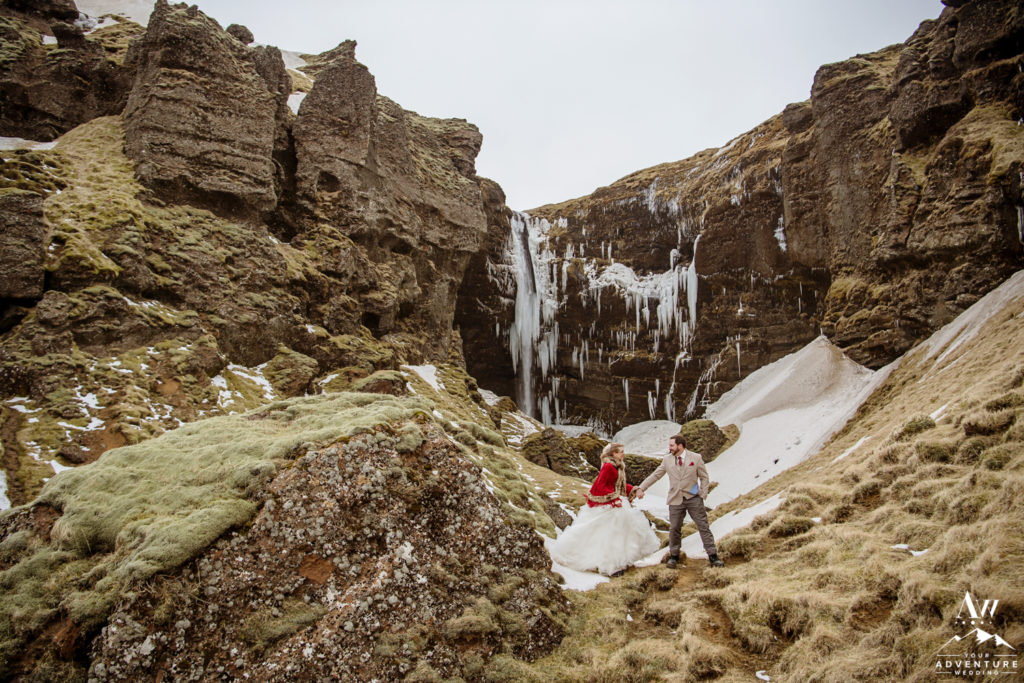 Iceland Wedding Couple exploring waterfall