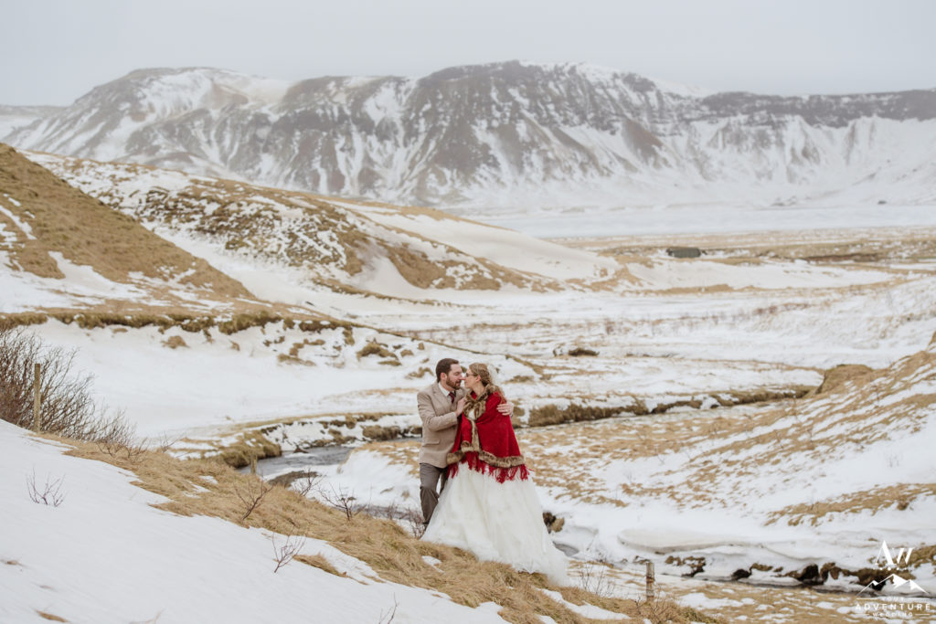 Couple hugging during March Elopement in Iceland
