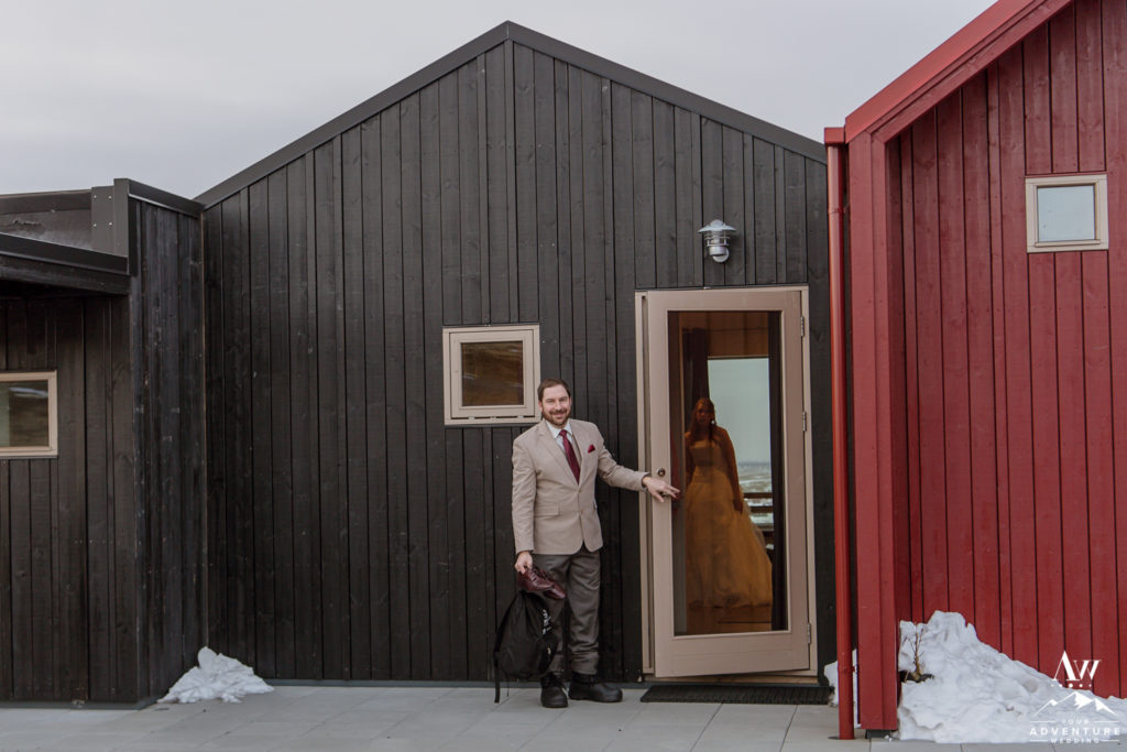 Groom Walking out of Hrifunes Guesthouse for Iceland Elopement