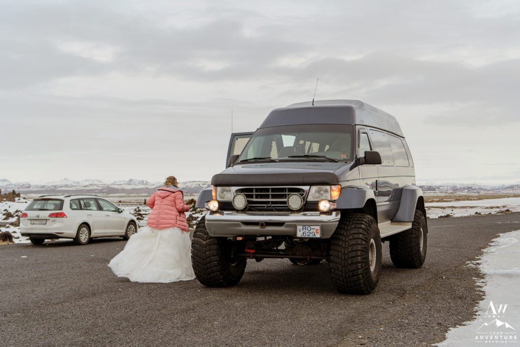 Bride getting into Super Jeep for Iceland Elopement
