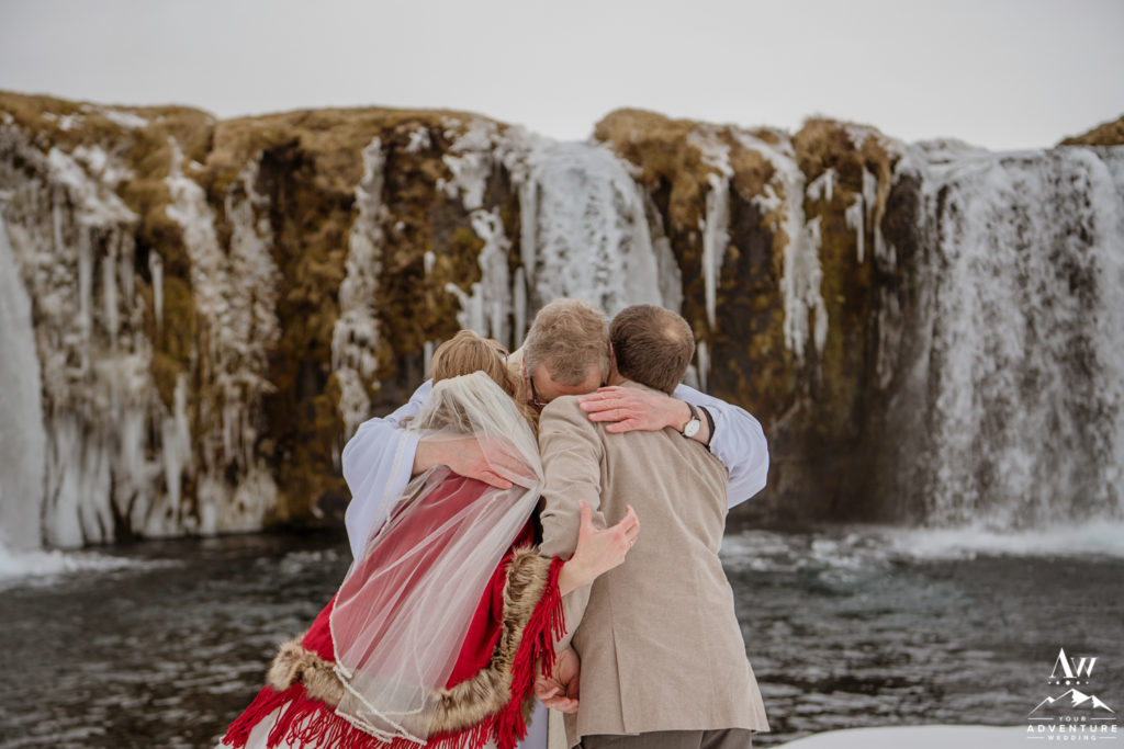 Iceland Wedding Celebrant hugging the couple after the ceremony