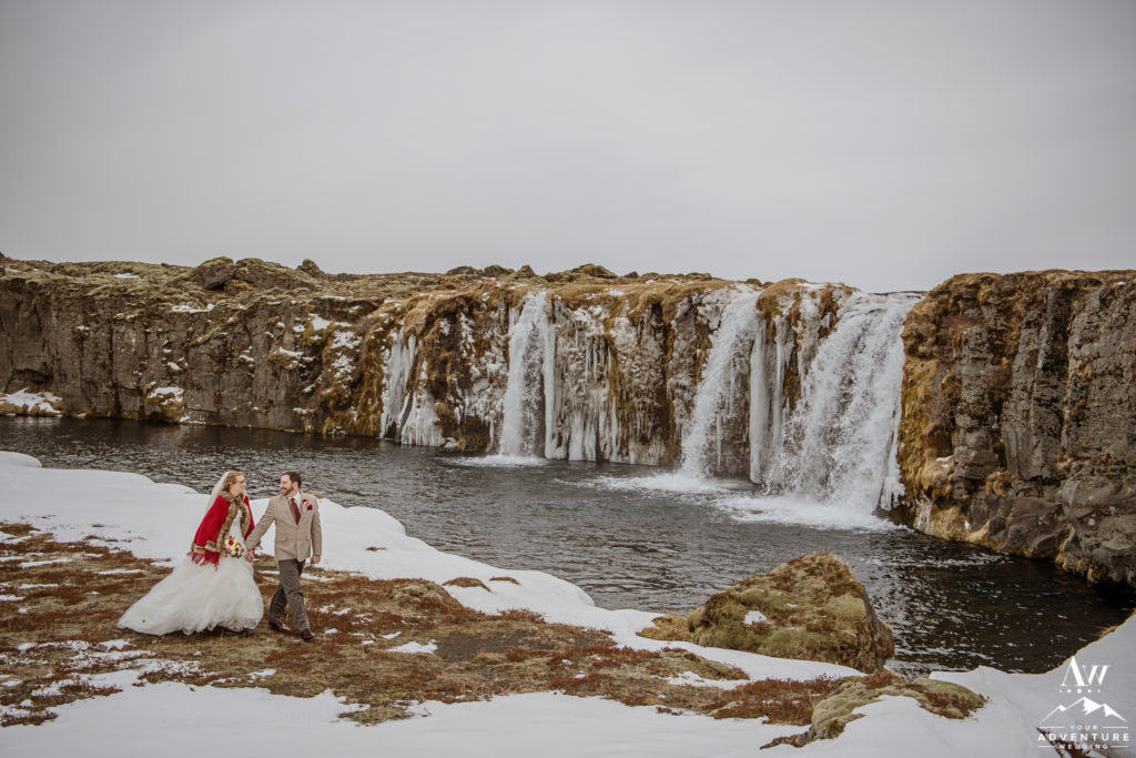Couple during Iceland adventure wedding at a private waterfall