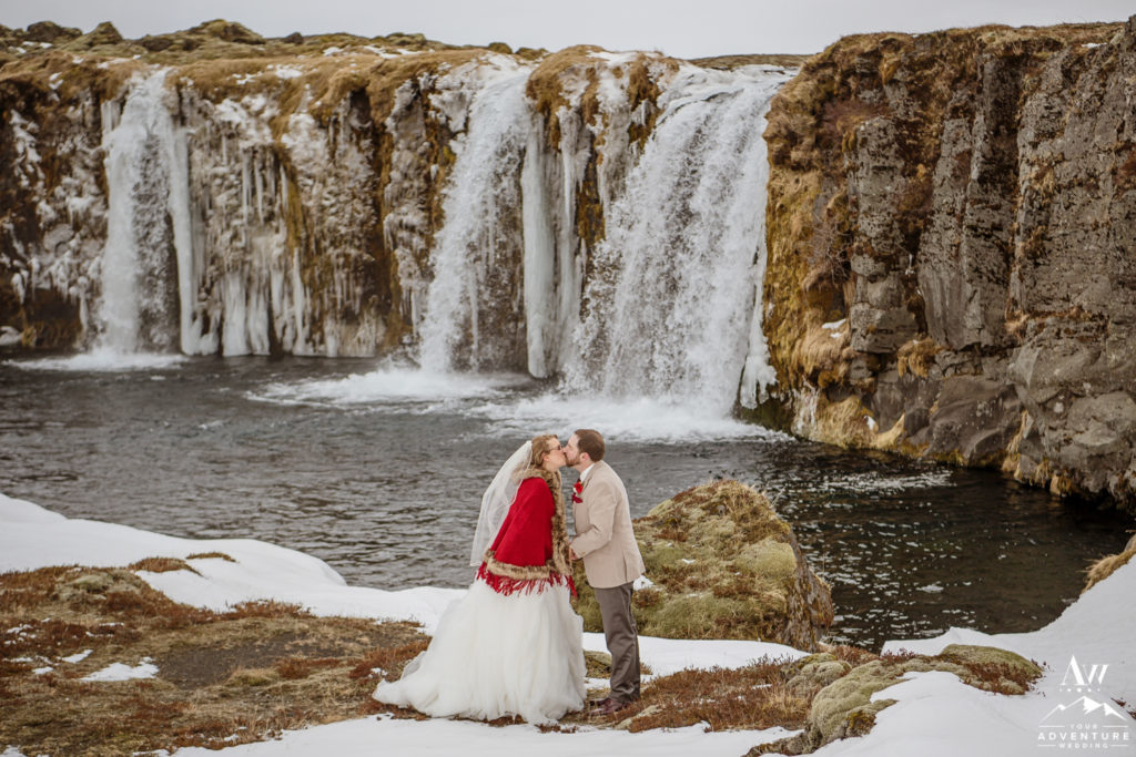 Iceland Elopement Couple Kissing in front of a private waterfall