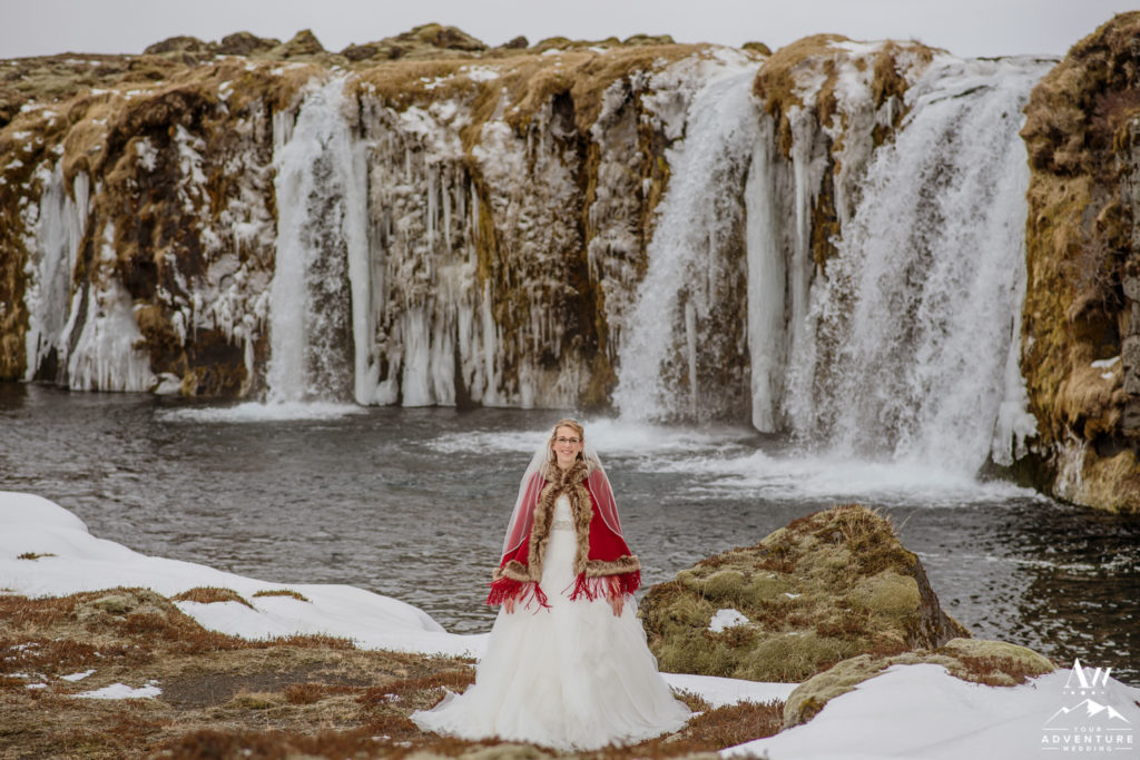 Iceland bride in front of private waterfall