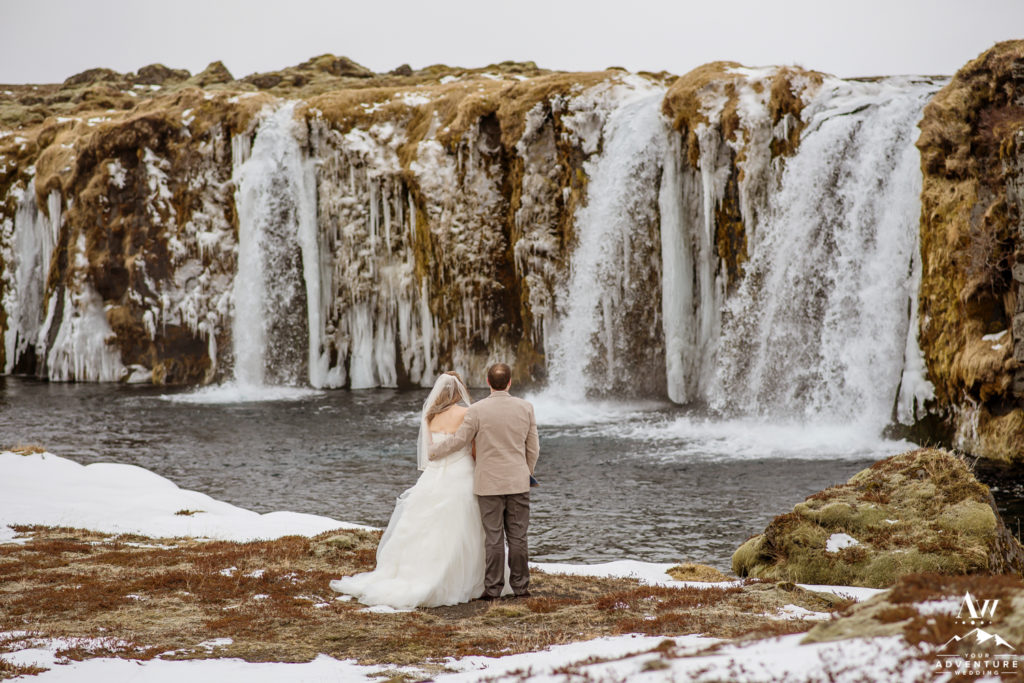 Iceland Elopement Couple enjoying their private waterfall