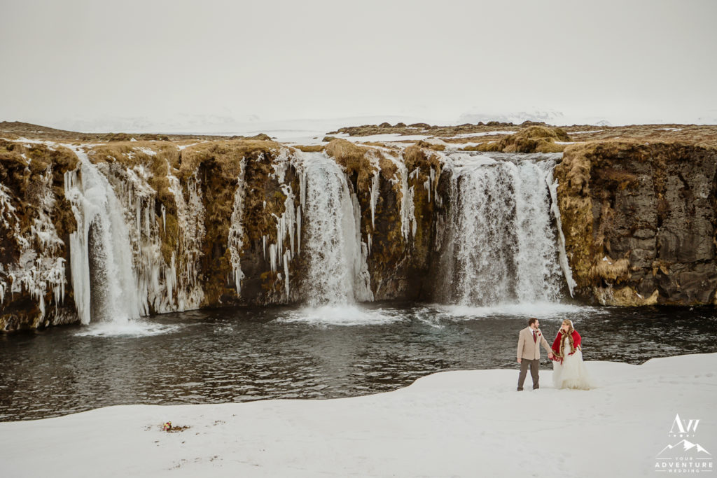 Iceland Elopement Couple exploring secret waterfall