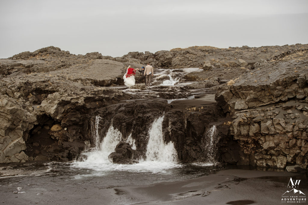 Iceland Elopement Couple exploring black beach waterfall