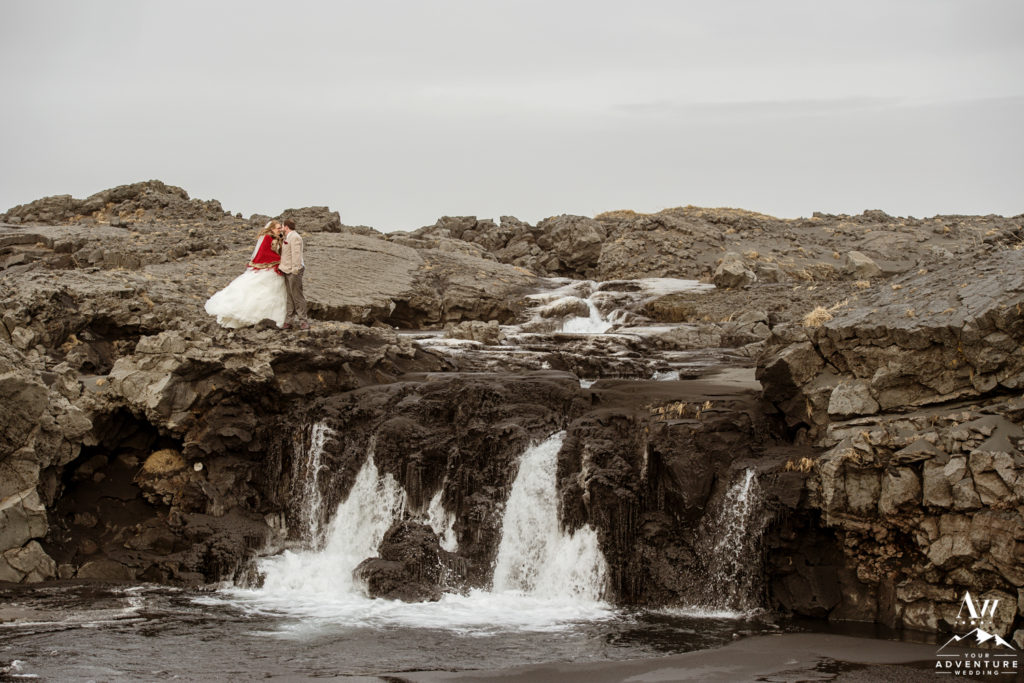 Adventurous Elopement Couple in Iceland on top of a waterfall