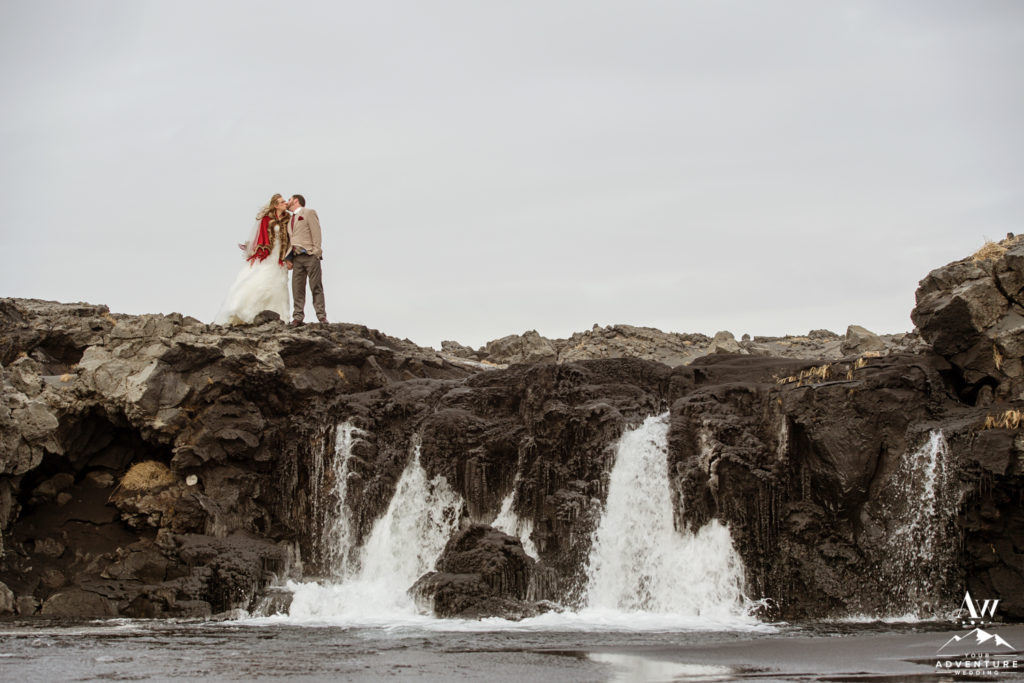 Iceland Wedding Couple kissing on top of a waterfall