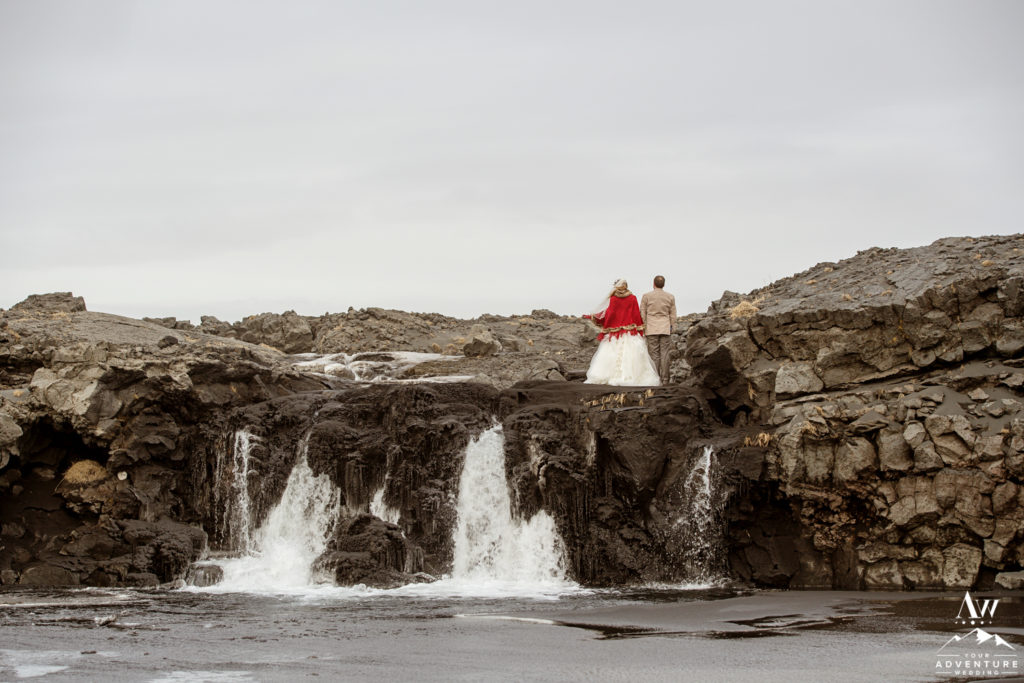 Iceland Wedding Couple Exploring a waterfall during Adventure Wedding Day