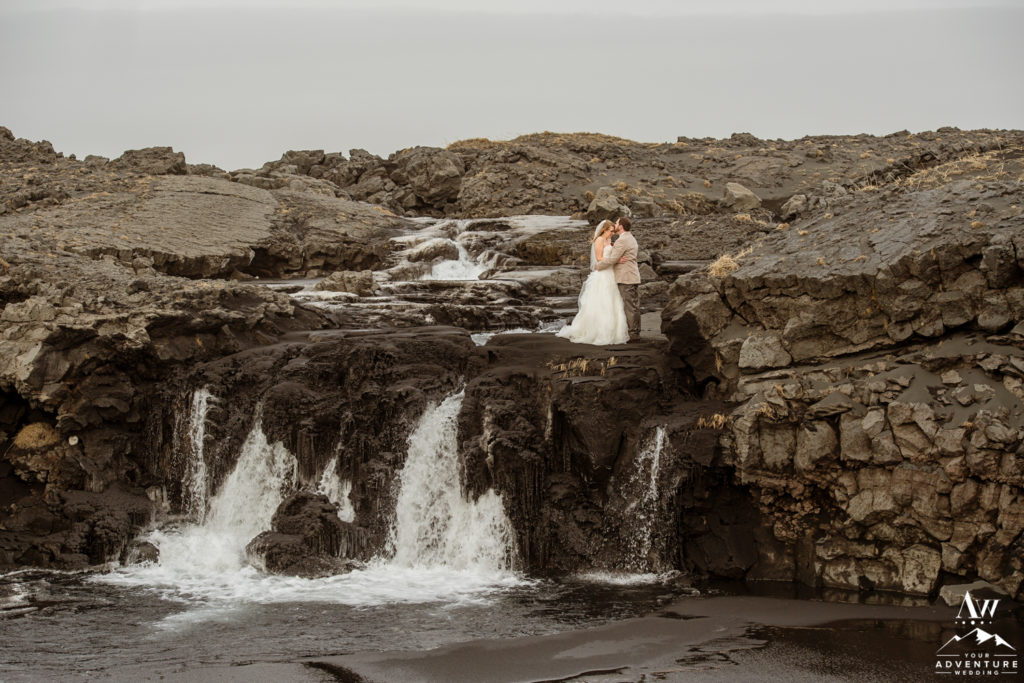 Winter Elopement Photos in Iceland Waterfall