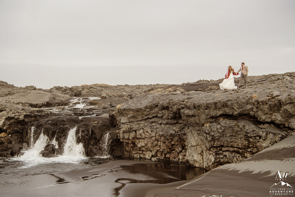 Iceland Wedding Couple Exploring Secret Waterfall