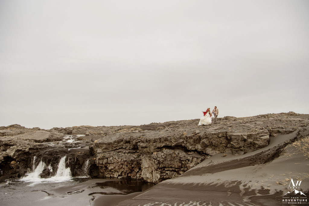 Couple Walking during March Elopement in Iceland