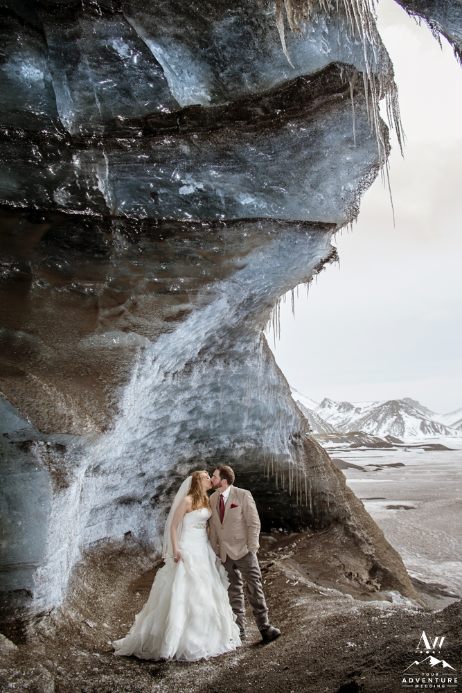 Couple kissing inside of an ice cave in Iceland