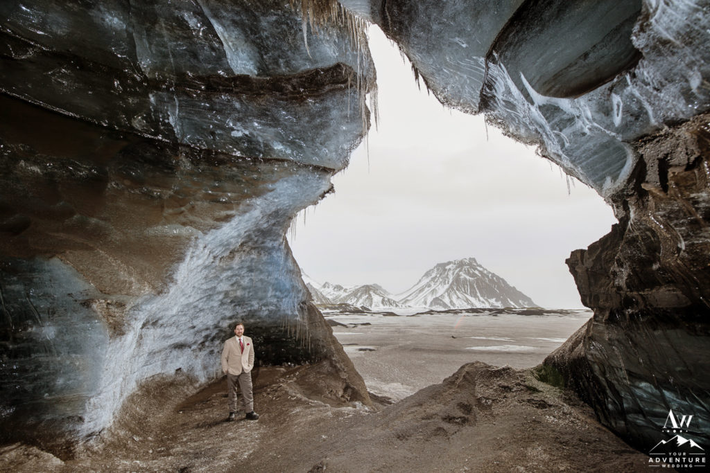 Adventurous Groom inside of an ice cave in Iceland