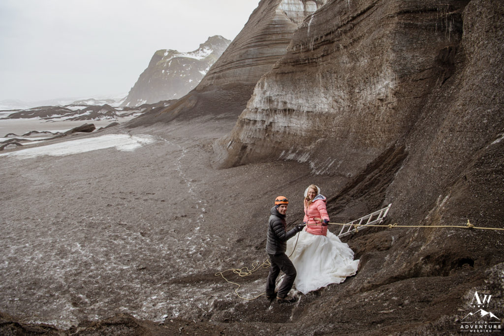 Bride hiking a glacier on wedding day