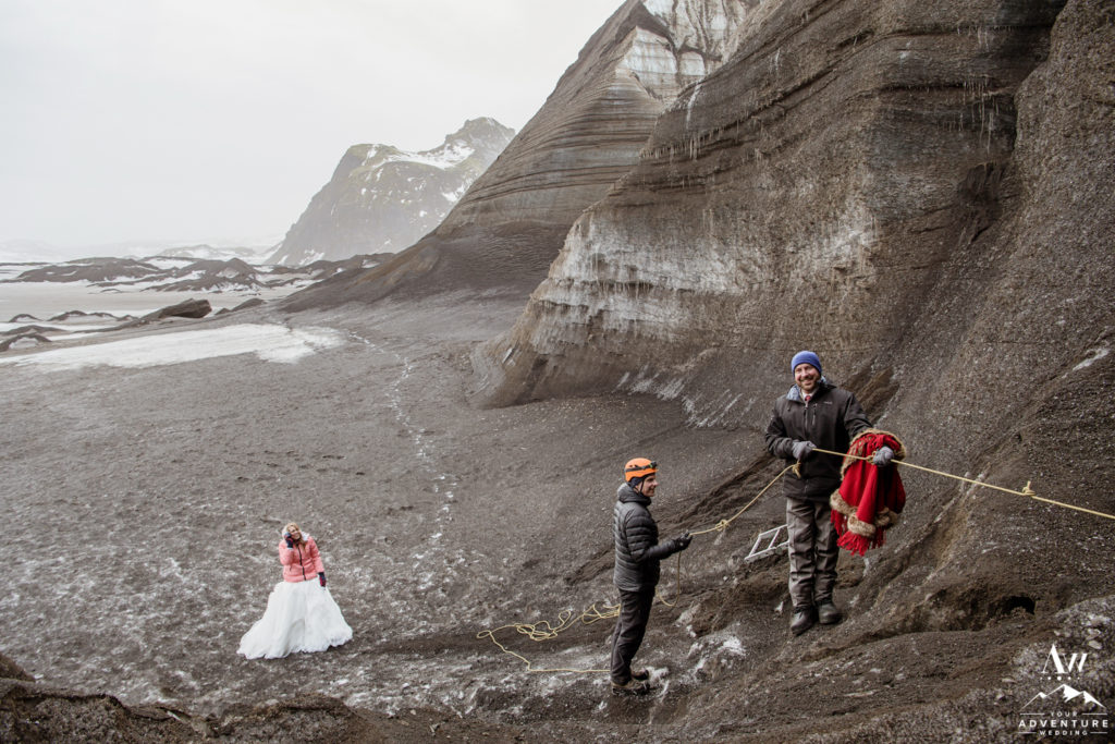 Groom Hiking a glacier on wedding day in Iceland