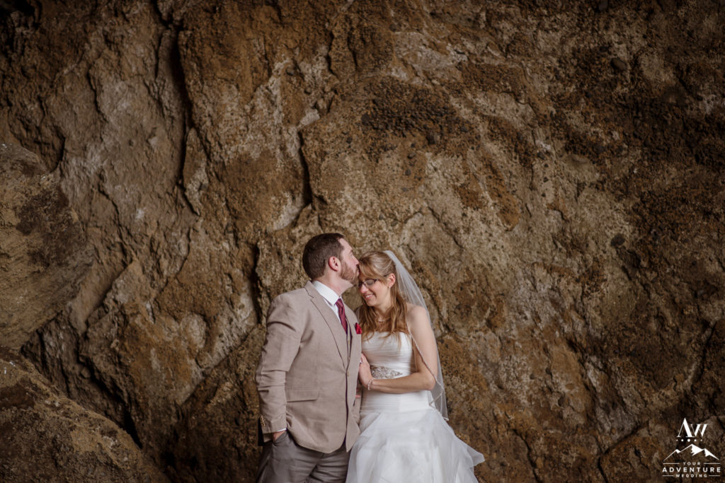 Forehead Kiss inside of natural cave in Iceland