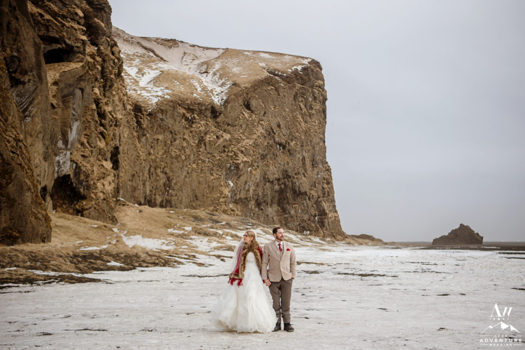 Couple standing in front of a mountain in Iceland