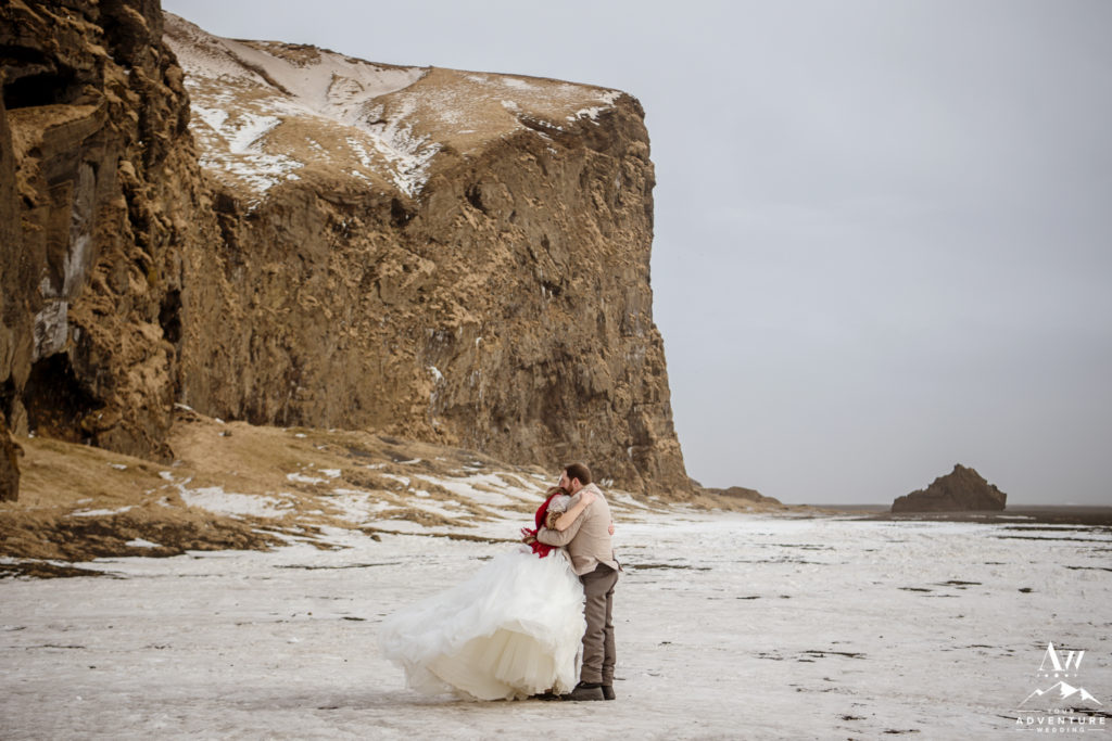 Couple hugging during Iceland Elopement adventure in March