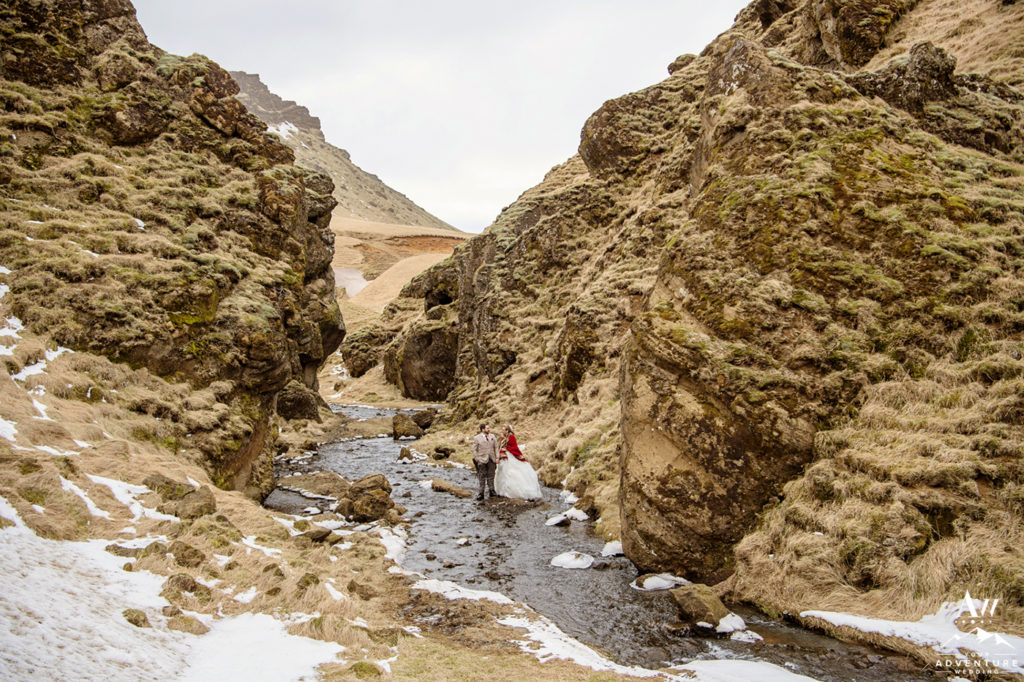 Couple Exploring a Private Canyon during Iceland Elopement
