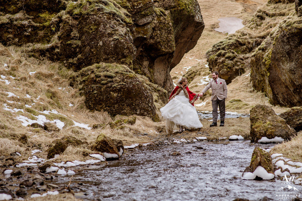 Bride and Groom exploring a private canyon on Iceland wedding day