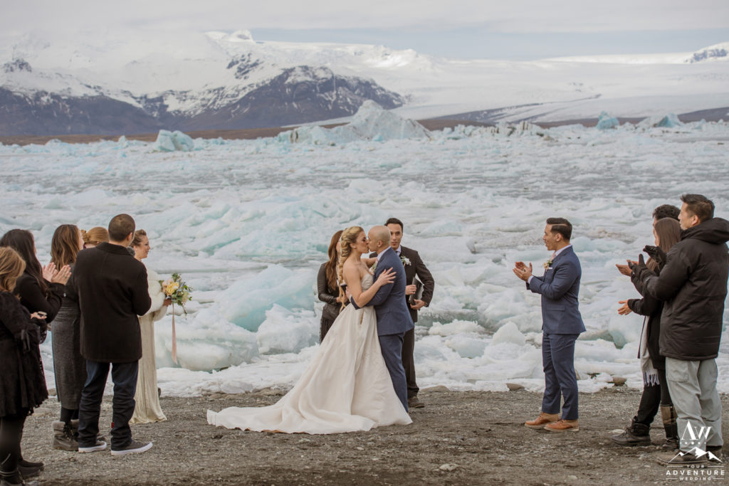Couple kissing during Iceland wedding ceremony at the glacier lagoon