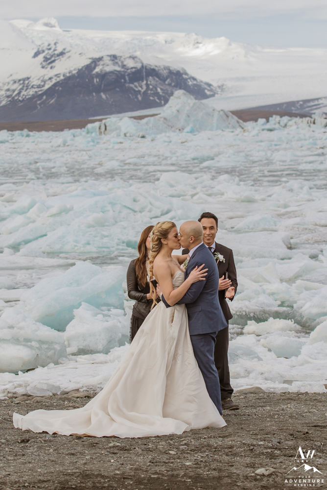 Iceland wedding ceremony couple kissing at the end