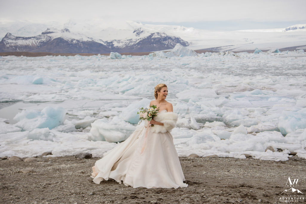 Bride Twirling at glacier lagoon during Iceland Wedding