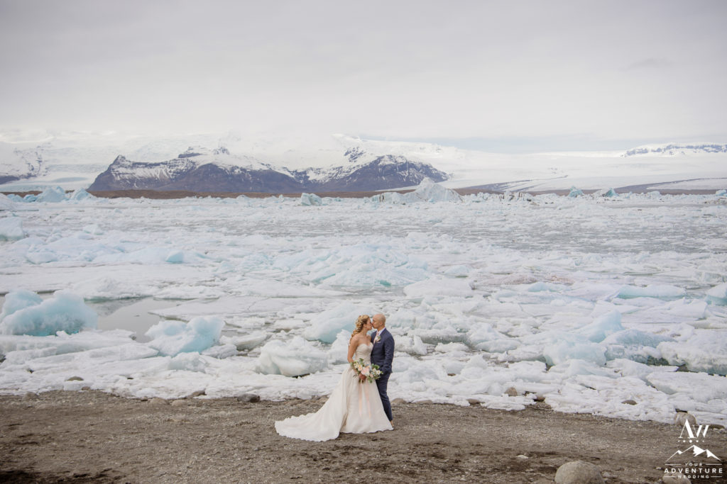 Iceland wedding couple kissing in front of glacier lagoon