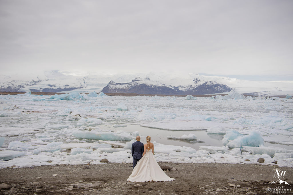 Iceland wedding couple looking out to the glacier lagoon